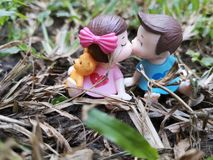 Closeup and macro shot of miniature kissing babies in the garden. royalty free stock photography