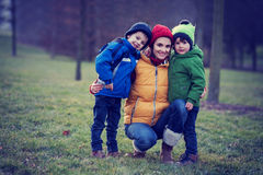 Adorable colorful portrait of a mother with her two boys royalty free stock photography
