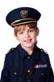 Adorable Cop. Portrait of a cheerful girl in a police officer's uniform.  Isolated on white Stock Images