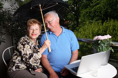 Adorable couple. Adorable senior couple using laptop. Great facial expressions Stock Photography