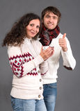 Adorable couple holding cup of coffee Stock Photos
