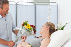 Adorable couple in a hospital room Stock Photo