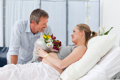 Adorable couple in a hospital room Stock Images