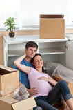 Adorable couple lying in their new house Stock Images