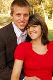 Adorable Couple in the Park. Very attractive couple in love posing for portraits Royalty Free Stock Image