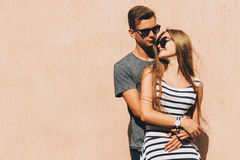 Adorable couple on a sunny day. In the city Stock Images