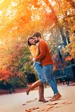 Adorable couple on a sunny day in the city park. Beautiful young couple embracing on a sunny day in the city park stock images
