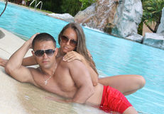 Adorable couple at the swimming pool Stock Photo
