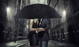 Adorable couple under the umbrella royalty free stock image