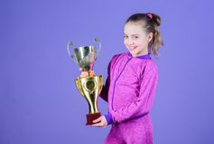 Adorable cup winner. Small girl holding silver cup. Little child with cup shaped sports trophy. Cute athlete being. Awarded with cup. Declaring the winner, copy stock images