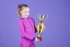 Adorable cup winner. Small girl holding silver cup. Little child with cup shaped sports trophy. Cute athlete being. Awarded with cup. Declaring the winner, copy stock photos