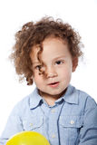 Adorable Curly Child in Casual Light Blue Shirt. Close up Adorable Child with Curly Blond Hair in Casual Light Blue Shirt Isolated on White Background Royalty Free Stock Photography