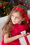 Adorable curly girl with Christmas present Royalty Free Stock Images