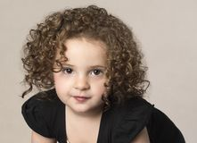 Adorable curly haired toddler girl stock image