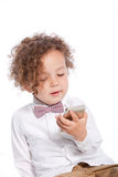 Adorable Curly Young Kid Looking at Mobile Phone Stock Photo