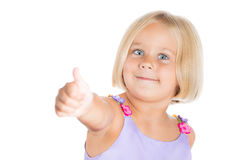 Adorable cute blonde girl giving a thumbs up sign Royalty Free Stock Photography