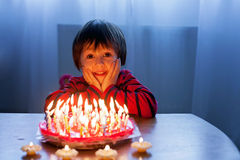 Adorable cute boy, blowing candles on a birthday cake Royalty Free Stock Photography