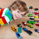 Adorable cute child with lot of different colorful toy cars Royalty Free Stock Images