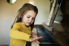 Adorable Cute Girl Playing Piano Concept. Adorable Cute Girl Playing Piano Stock Image