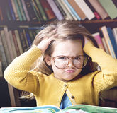 Adorable Cute Girl Stressed Out Reading Concept stock images