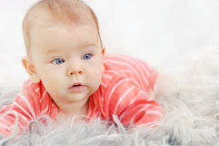 Adorable cute little girl with big blue eyes on the sofa Royalty Free Stock Photo