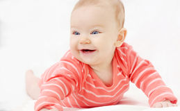 Adorable cute little girl with big blue eyes and wide smile play Stock Photos