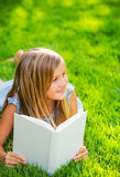 Adorable cute little girl reading book Stock Images