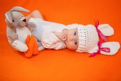 Adorable cute newborn baby girl dressed in rabbit costume royalty free stock photography