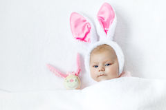Adorable cute newborn baby girl in Easter bunny costume and ears. Royalty Free Stock Photography