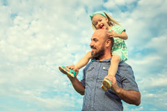 Adorable daughter and father portrait, future concept. Adorable daughter and father portrait, happy family, future concept Stock Image