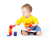 Adorable dirty child with paints Stock Photo