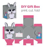 Adorable Do It Yourself DIY rabbit gift box with ears for sweets, candies, small presents. Printable color scheme. Print it on thick paper, cut out, fold Royalty Free Stock Photo