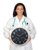Adorable doctor with a big clock Royalty Free Stock Images