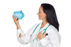 Adorable doctor with money-box Royalty Free Stock Photos