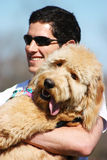 Adorable Dog. A friendly playful dog is held up during the Zilker Park Kite Festival in Austin, TX Royalty Free Stock Images