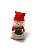 Adorable doll. Santa claus doll with the curious face royalty free stock photos