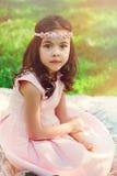 Adorable dressy child girl in spring garden Stock Photo