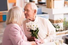 Adorable elderly couple kissing Royalty Free Stock Photo
