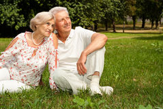 Adorable elderly couple went to the nature. Good-looking elderly couple went to the nature on weekends Stock Photos