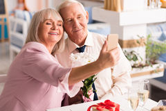Adorable elderly love birds making a selfie Stock Image