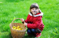 Adorable face painted child girl in the garden Stock Image