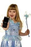 Adorable fairy girl showing the phone. A little girl dressed up in a fairy costume is showing the phone royalty free stock photos