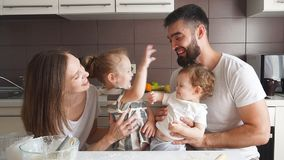 Adorable family cooking together in the kitchen with modern interior