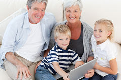 Adorable family looking at their laptop Royalty Free Stock Image