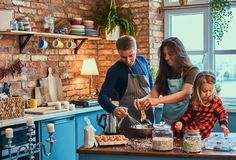 Adorable family together cooking breakfast in loft style kitchen. Family concept. Adorable family together cooking breakfast in loft style kitchen stock photos