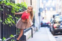 Adorable fashion little girl outdoors in European city Stock Photos