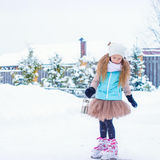 Adorable fashion little girl skating on the ice Royalty Free Stock Images