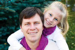 Adorable father and daughter have fun together happy smiles. hea Stock Photography