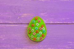Adorable felt Easter egg ornament with floral pattern  on a wooden background with copy space. Simple Easter sewing. Simple handmade toy. How to hand sew a felt Stock Photos