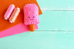 Adorable felt ice cream toy. Felt play food pattern. DIY felt food. Easy fabric crafts for kids. Thread, brown and pink wool sheet Stock Photography